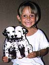 Child and dalmations